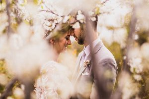 san diego wedding photographer - engagement couple with white flowers