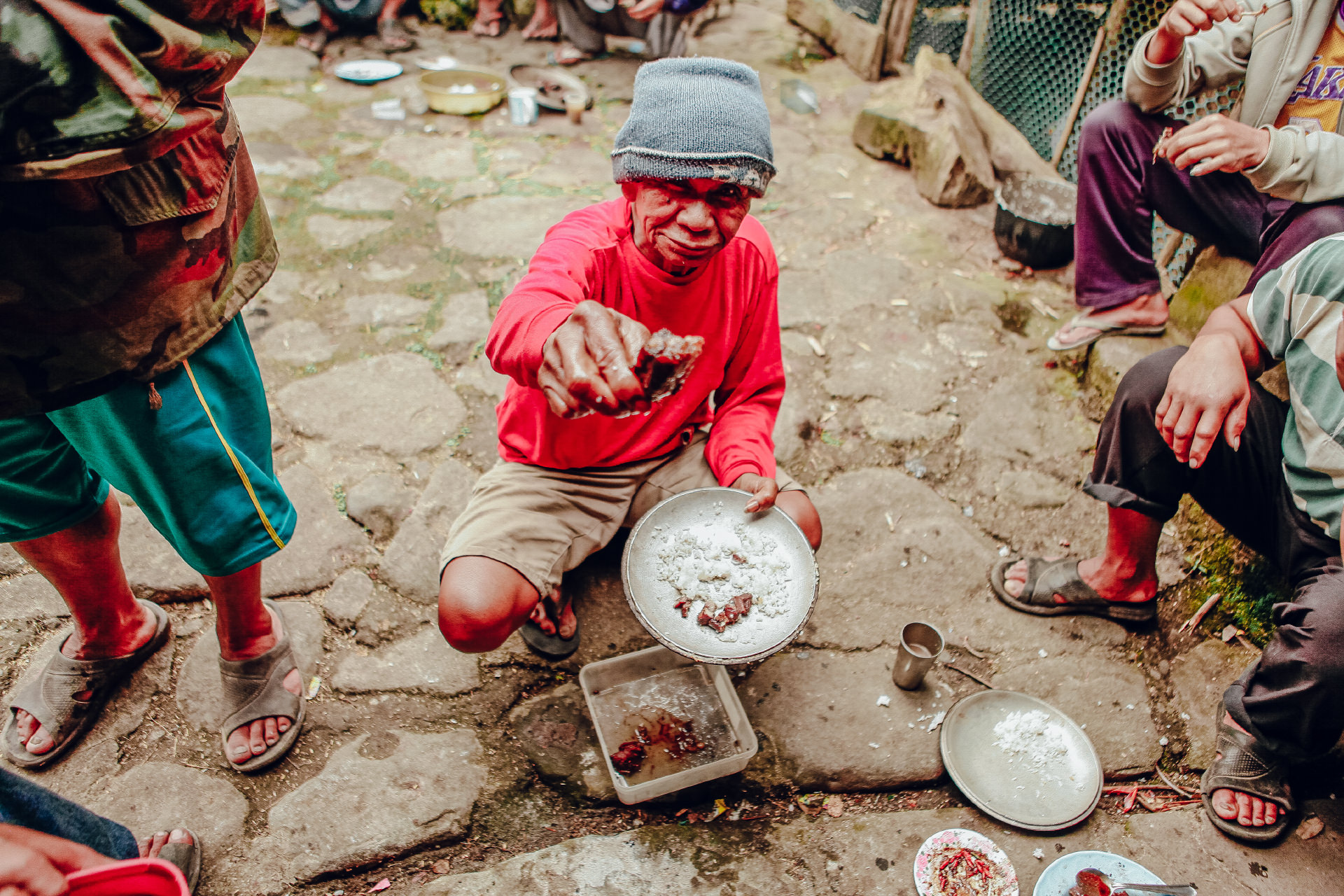 Man offering his food